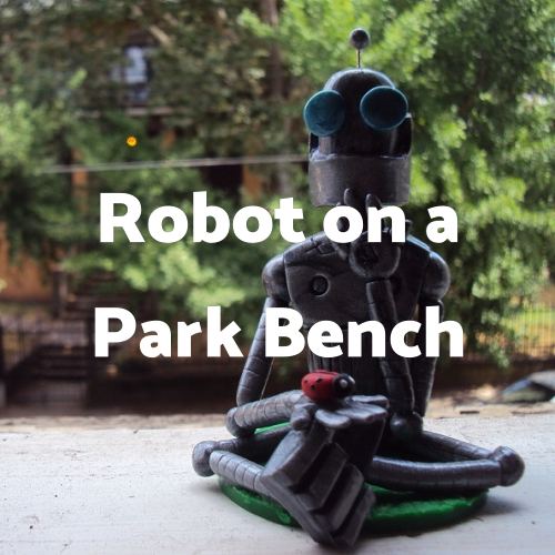 Robot on a Park Bench in Delmarva Review